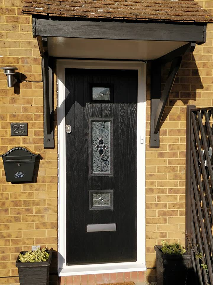 A black door installed at the front of a house