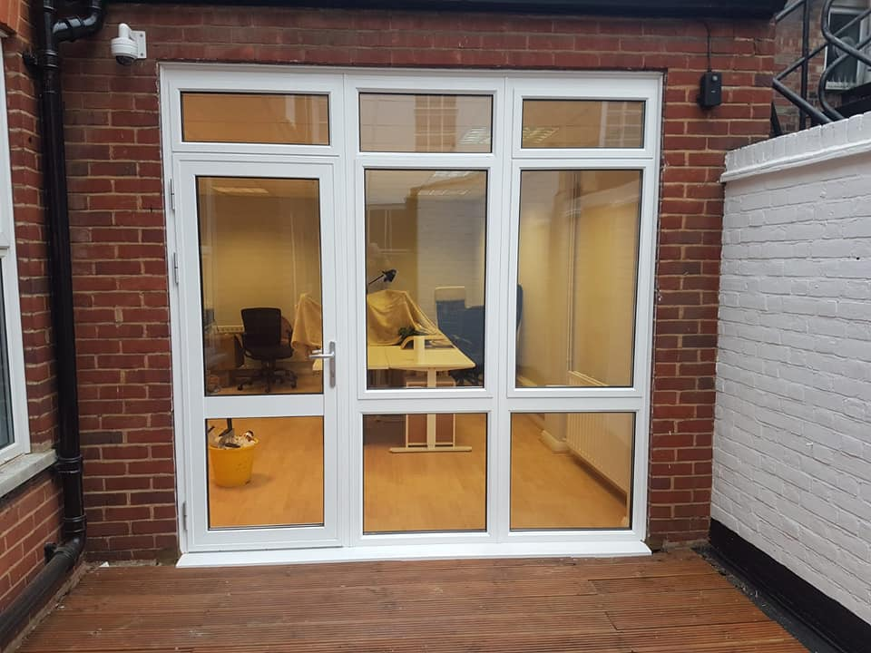 Image of a white door and windows with glass panels